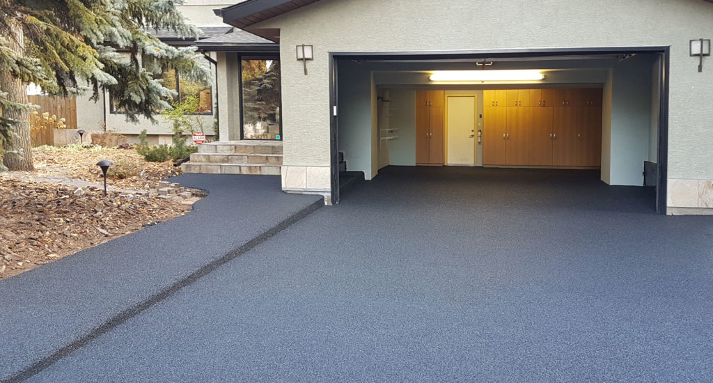 Kelowna Rubber Paving Company. New rubber pavement rsurfaces old concrete rubber paving services in Kelowna rubber paving contractor